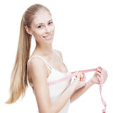 Young blond woman measuring waist Royalty Free Stock Photos