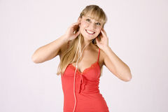 Young blond woman with mp3-player Stock Image