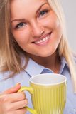 Young blond woman with mug Stock Photography