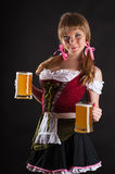 Young blond woman with Oktoberfest beer Royalty Free Stock Photography