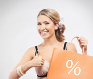 A young blond woman with an orange shopping bag Stock Photo
