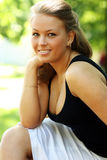 Young blond woman. Young woman on outdoor background Royalty Free Stock Photos