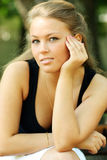 Young blond woman. Young woman on outdoor background Royalty Free Stock Images