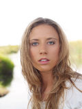 Young blond woman outdoor portrait in white top. Young blond woman in white top outdoor portrait Royalty Free Stock Photo
