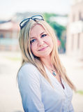 Young blond woman outdoors Royalty Free Stock Photography
