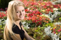 Young blond woman in park Royalty Free Stock Images