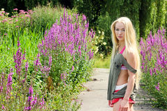 Young blond woman in park Royalty Free Stock Image