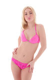 A young blond woman in pink erotic lingerie Stock Photos