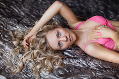 Young blond woman in pink lingerie Royalty Free Stock Photos