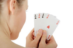Young blond woman playing cards Stock Photos