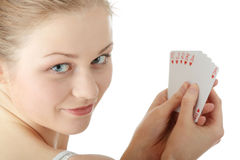 Young blond woman playing cards Stock Photography