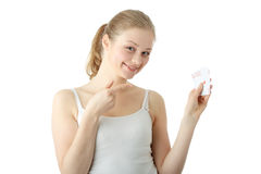 Young blond woman playing cards Royalty Free Stock Photography