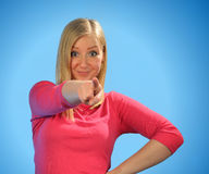 Young blond woman pointing a finger. Stock Photo