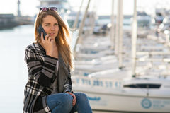 Young blond woman portrait on the background of yachts Stock Images