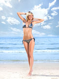 A young blond woman posing on the beach Royalty Free Stock Photos