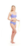 A young blond woman posing in blue lingerie Stock Photos