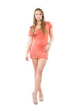 Young blond woman. Posing in pink dress. Isolated on white royalty free stock photo
