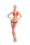 A young blond woman posing in a red swimsuit Royalty Free Stock Photography