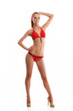 A young blond woman posing in a red swimsuit Royalty Free Stock Photo