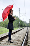 Young blond woman on railroad Stock Photography