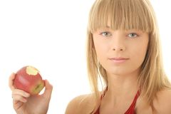 Young blond woman with red apple Stock Photo
