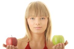Young blond woman with red and green apples Royalty Free Stock Images