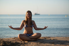 Relaxing yoga girl Stock Images