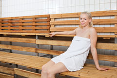 Young blond woman relaxing in sauna Stock Image