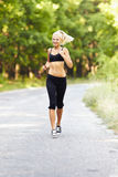 Young blond woman running Stock Photo