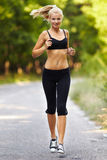 Young blond woman running Royalty Free Stock Photo