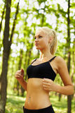 Young blond woman running Royalty Free Stock Image
