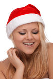 Young blond woman in santa hat Stock Image