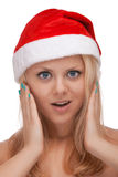 Young blond woman in santa hat Royalty Free Stock Photography