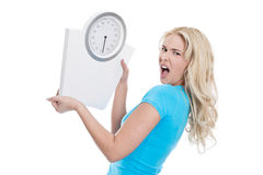 young blond woman with a scales in hand isolated o Royalty Free Stock Images