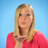 Young blond woman sends kiss. Stock Photos