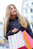 Young blond woman shopper Stock Photography