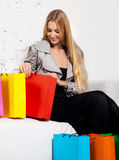 Young blond woman after shopping Royalty Free Stock Images