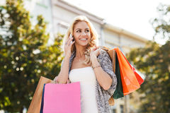 Young blond woman with shopping bags Royalty Free Stock Image
