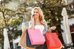 Young blond woman with shopping bags Stock Photos