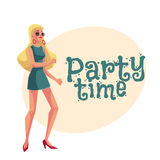 Young blond woman in short 1960s style dress dancing disco Stock Images