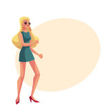 Young blond woman in short 1960s style dress dancing disco Stock Image