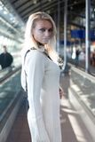 Young blond woman with shoulder bag Royalty Free Stock Photos