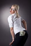 Young blond woman show money in jeans Stock Photos