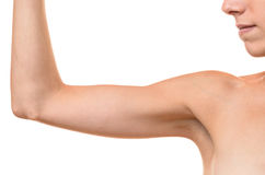 Young blond woman showing flabby arm Royalty Free Stock Photo