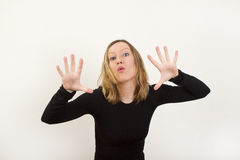 Young blond woman showing her palms Stock Photo