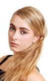 Young blond woman side portrait Royalty Free Stock Image