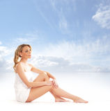 A young blond woman sitting after taking a bath Stock Image