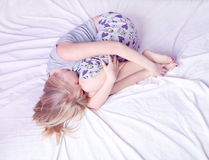 Young blond woman sleeping in her bed Stock Photos