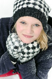Young blond woman with beanie and scarf winter wood portrait Stock Photo