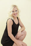 Young blond woman smiling Royalty Free Stock Images